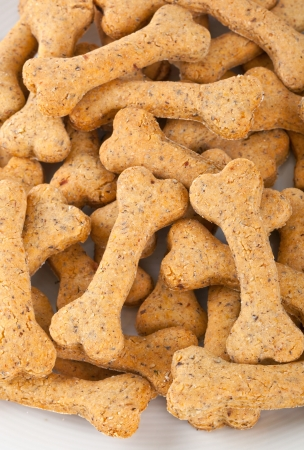 Dog biscuits on white background photo