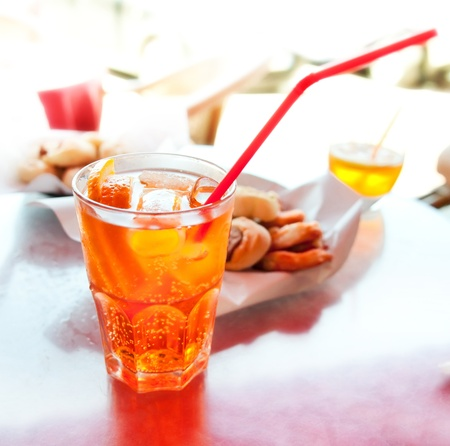 refreshment: Long drink Spritz with oranges on table