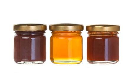 honey apple: Three jar of jam and honey on white background Stock Photo
