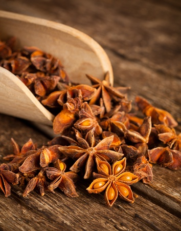 Stars anise on wooden table photo