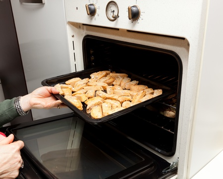 Baking in the oven of italian cookies cantucci photo