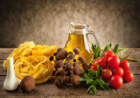 Ingredients for cooking noodles with mushrooms. photo