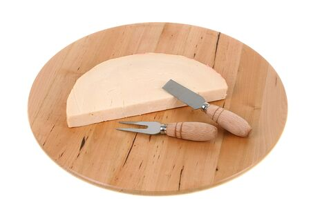 preperation: Italian spicy provolone cheese with cheese knife on white background