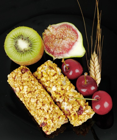 Breakfast with fruits and energy bar photo