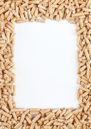 wood pellets: Wood pellets forming a frame Stock Photo