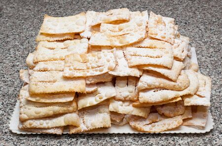 chiacchiere: Chiacchiere or frappe italian cake on table Stock Photo