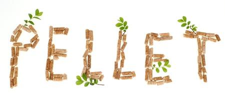 Texte boulette faite par des granulés de bois sur fond blanc