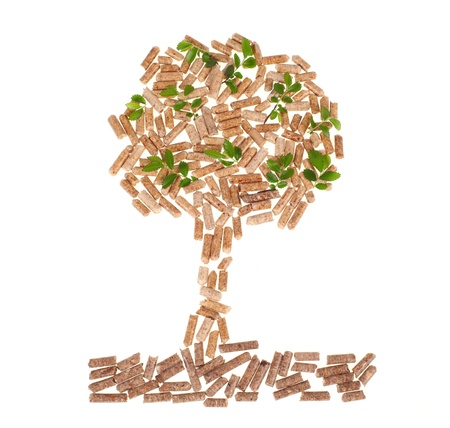 wood pellet: Tree of wood pellet on white background with leaves Stock Photo