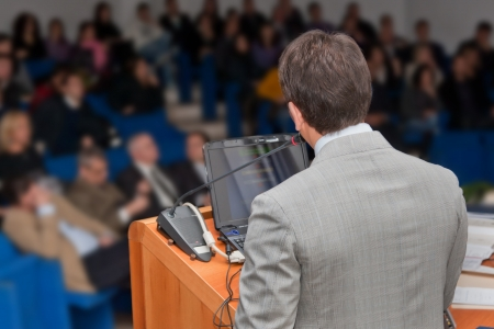 spokesman: Business people group at meeting seminar presentation.