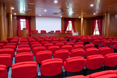 conference centre: Conference centre with red armchairs Stock Photo