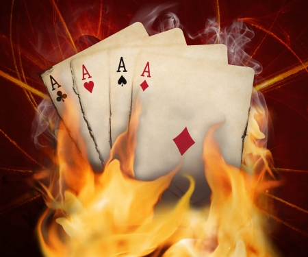 ace hearts: Poker cards burn in the fire.