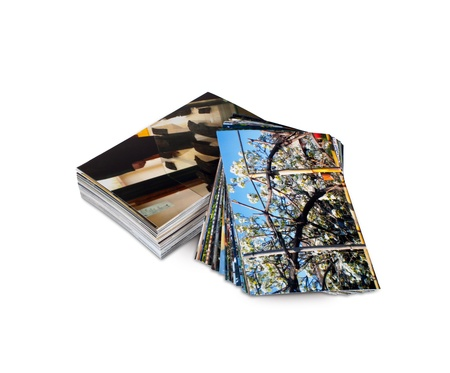 printed media: Pile of photos printed on photo paper