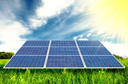 Solar Panels in a field of Grass Stock Photo