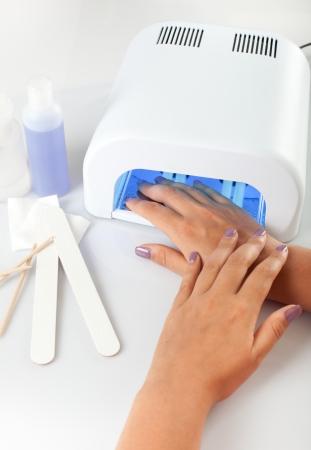 手の爪の uv ランプで 写真素材