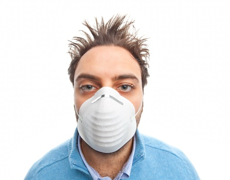 Young boy with mask respiratory protection on white background