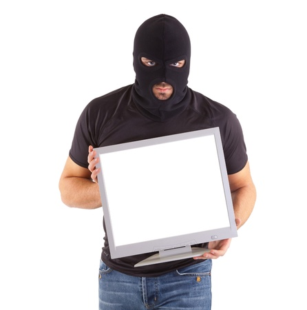 Criminal with balaclava mask is robbing a monitor on white background photo