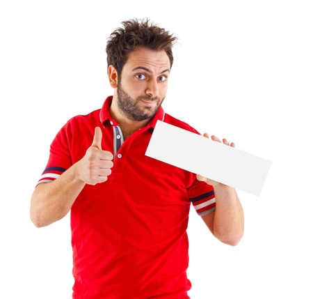 displaying: Happy young man showing and displaying placard Stock Photo