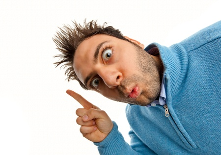 crazy man: Young boy with a surprised expression pointing on white background