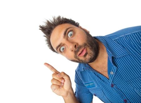 Jeune garçon avec une expression de surprise pointant sur fond blanc Banque d'images - 20561509