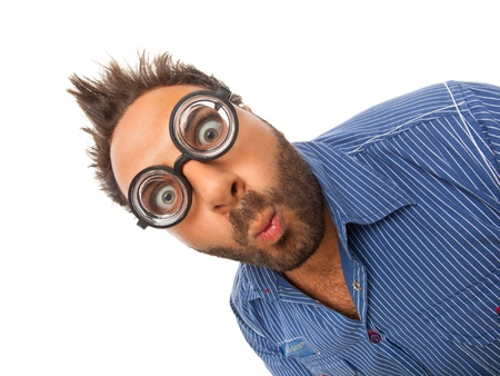 Young boy with a surprised expression with eye glasses