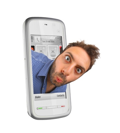Young boy with a surprised expression in the smartphones Stock Photo