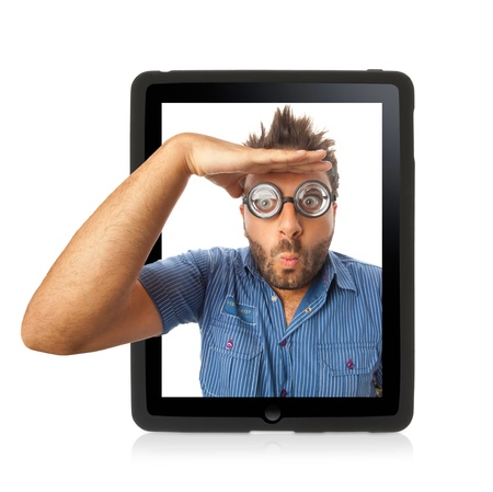 astigmatism: Young boy with a surprised expression in the tablet