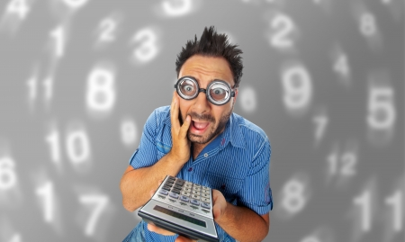 Young boy with a surprised expression with calculator Stock Photo