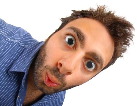 sch�ler: Junge mit einem �berraschten Ausdruck mit Dilatation Sch�ler auf wei�em Hintergrund Lizenzfreie Bilder