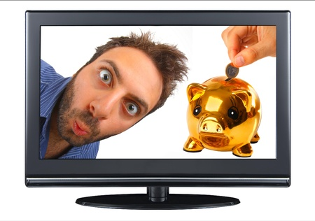 Young boy with a surprised expression in the tv with piggy bank photo