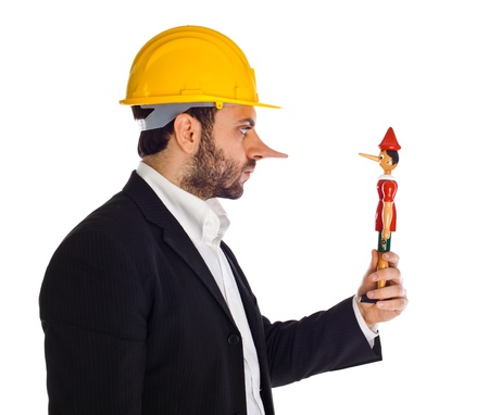 lie: Businessman with Pinocchio on white background