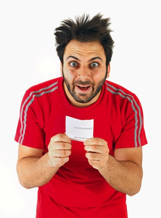 suspicious man: Young boy with a surprised expression bet slip on white background
