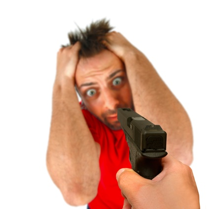 threatened: Man threatened with a gun on white background