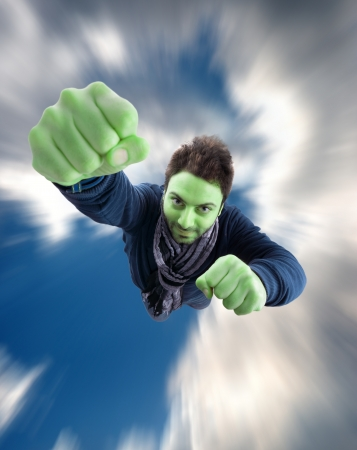are thrust: Green Superhero with fist thrust forward flying in the sky