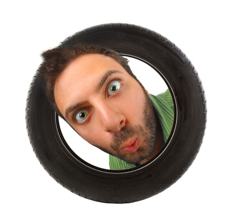 Wow expression in the car tire on white background photo