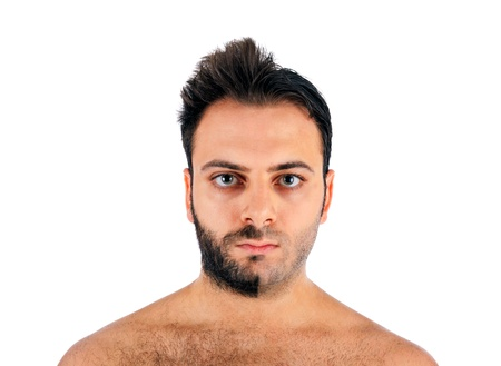 brute: A young man with a beard on half of the face on white background Stock Photo
