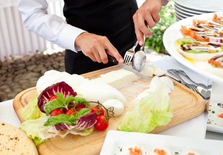 nutriments: Sliced mozzarella from the waiter during a wedding reception Stock Photo