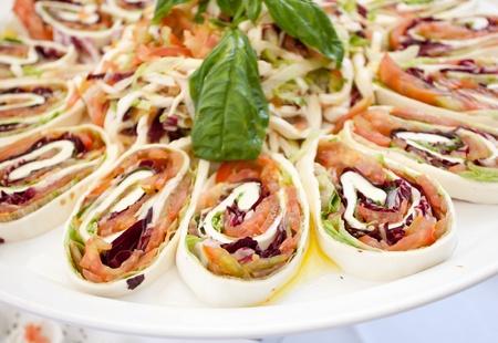Roll with tomato mozzarella cheese raw ham. photo