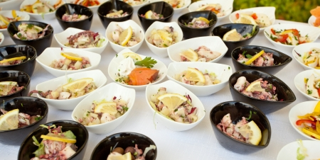 Buffet bowls with a variety of fish and shellfish finger food Stock Photo - 21188604
