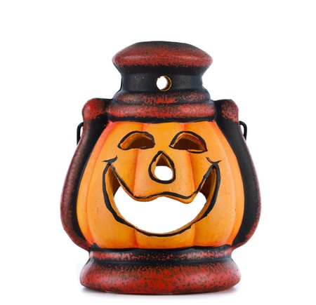 pumpkin lantern with candle inside lit on white background photo