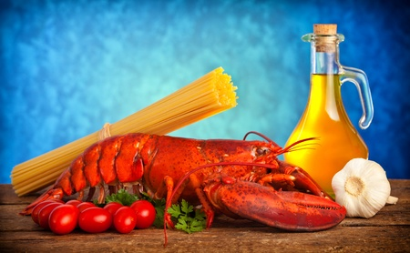 Ingredients of lobster with linguine on wooden table photo