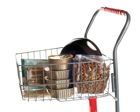 dog food: Sshopping cart full of dog food on white background Stock Photo