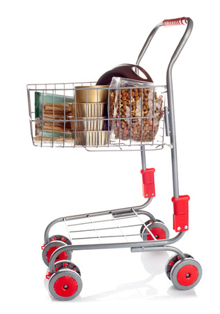 Sshopping cart full of dog food on white background photo