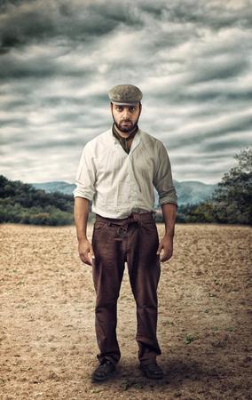 exploitation: Angry farmer on a empty land. Stock Photo