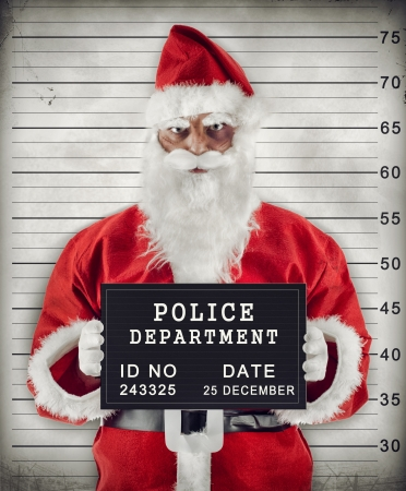 criminal: Mugshot of Santa Claus criminal under arrest. Stock Photo