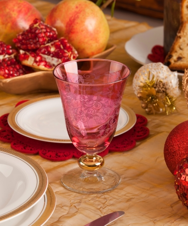 Detail of a glass of Murano in a Christmas table. photo