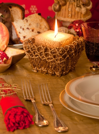Table decorated for Christmas dinner with warm lighting photo