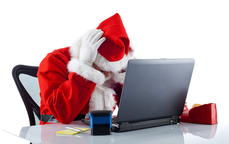 Young Santa Claus with notebook on white background photo