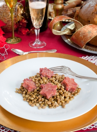 trotter: Pig trotter star shaped with lentils over christmas table.