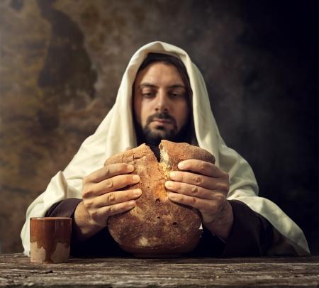 jesus christ communion: The Last Supper, Jesus breaks the bread. Stock Photo