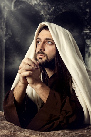 Jesus praying and looking up to heaven while he cries. photo